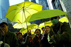Supporters hold yellow umbrellas as Hong Kong student leaders arrive at the police headquarters in Hong Kong